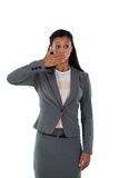 Surprised businesswoman covering her mouth with hand. Against white background Royalty Free Stock Photos