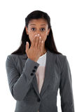 Surprised businesswoman covering her mouth with hand. Portrait of surprised businesswoman covering her mouth with hand Royalty Free Stock Photos