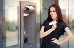 Surprised Businesswoman with Credit Card at ATM cash machine Stock Photo