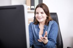 Surprised Businesswoman Facing at Computer Screen Royalty Free Stock Image