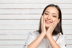 Surprised businesswoman with hands up. Amazed or shocked by unexpected news Royalty Free Stock Photography