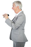 Surprised businesswoman holding binoculars Stock Images