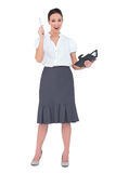 Surprised businesswoman holding her datebook. On white background Royalty Free Stock Photography