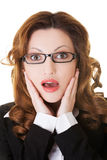 Surprised businesswoman holding her head. Stock Photography