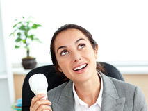 Surprised businesswoman holding a light bulb Royalty Free Stock Images
