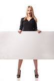 Surprised businesswoman holding placard Royalty Free Stock Photo