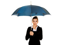 Surprised businesswoman holding an umbrella.  Stock Photography