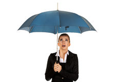 Surprised businesswoman holding an umbrella.  Royalty Free Stock Photo