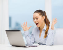 Surprised businesswoman with laptop Royalty Free Stock Photography