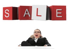 Surprised  businesswoman looking at sale sign. Isolated on white Stock Image