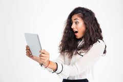 Surprised businesswoman looking at tablet computer Royalty Free Stock Image