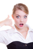 Surprised businesswoman making call me gesture. Business communication. Attractive businesswoman with eyes and mouth wide open making call me gesture. Surprised Royalty Free Stock Photo