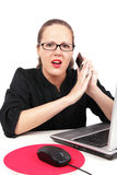 Surprised businesswoman with mobile stock photo