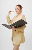 Surprised businesswoman with open folder Royalty Free Stock Image