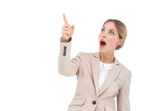 Surprised businesswoman pointing something Royalty Free Stock Images