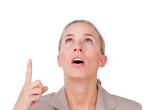 Surprised businesswoman pointing upward Royalty Free Stock Photos