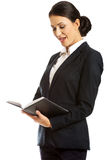 Surprised businesswoman reading her notes Stock Photography