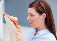 Surprised businesswoman reading newspaper Stock Photos