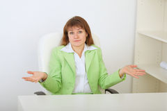 Surprised businesswoman shrugs Stock Photo