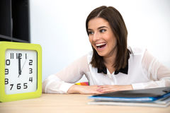 Surprised businesswoman sitting at the table Royalty Free Stock Image