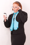 Surprised Businesswoman with smartphone Royalty Free Stock Photos