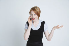 Surprised Businesswoman Using Cell Phone Stock Photo