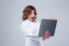 Surprised businesswoman using laptop Royalty Free Stock Image