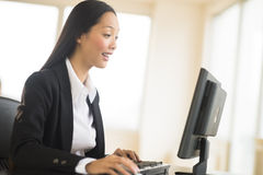 Surprised Businesswoman Working On Desktop PC Royalty Free Stock Photography