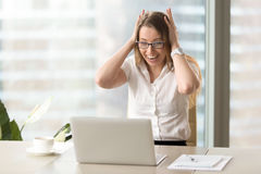 Surprised businesswoman yelling with head in hands stock photos