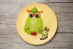 Surprised camel made of vegetables on wooden background Stock Photography