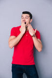 Surprised casual man covering his mouth Stock Photo