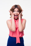 Surprised casual woman looking at camera Stock Photography