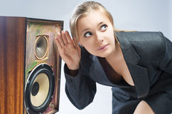 Surprised Caucasian Blond Female Harkens to Outdated Loudspeaker Royalty Free Stock Photography