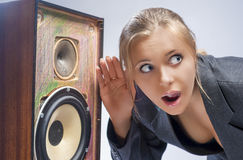 Surprised Caucasian Blond Female Harkens to Outdated Loudspeaker Royalty Free Stock Images