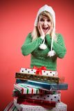 Surprised caucasian girl with gifts Royalty Free Stock Photography