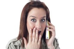 Surprised caucasian girl speaking on the phone. Isolated on white Stock Image