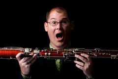 Surprised Caucasian Male Holding Bassoon Stock Photography