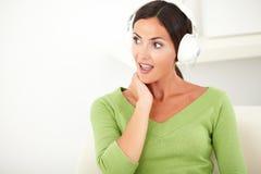 Surprised caucasian woman listening to music Royalty Free Stock Photos
