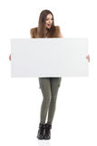 Surprised Causal Woman Holds White Placard Stock Image