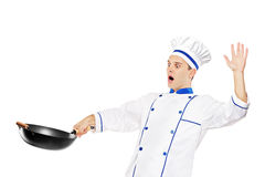 A surprised chef holding a wok Royalty Free Stock Image