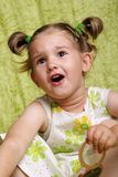 Surprised child. Surprised beautiful little girl on the green background Royalty Free Stock Photography