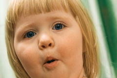 Surprised  child. With dark blue eyes Royalty Free Stock Photo