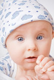 Surprised child in blue cap Royalty Free Stock Photos