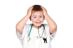 Surprised child with doctor uniform Stock Images