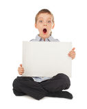 Surprised child with empty blank Royalty Free Stock Images