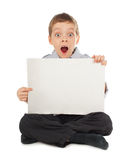 Surprised child with empty blank Royalty Free Stock Image