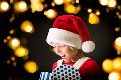 Surprised child holding Christmas gift box Royalty Free Stock Images