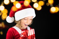 Surprised child holding Christmas gift box Stock Photography