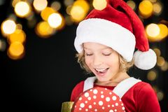 Surprised child holding Christmas gift box Royalty Free Stock Photos