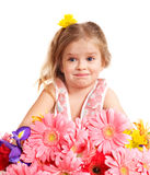 Surprised child holding flowers. Stock Photo
